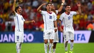 Jogadores chilenos em jogo contra a Espanha. Foto: Getty Images
